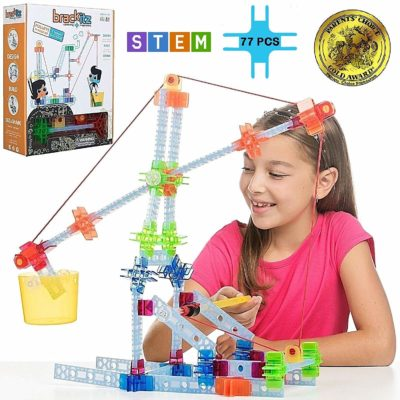 This is an image of a little girl playing with a pulley playset for kids.