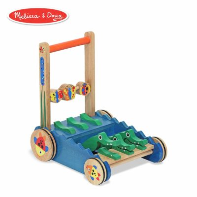 This is an image of a chomp and clack alligator wooden push toy designed for kids.