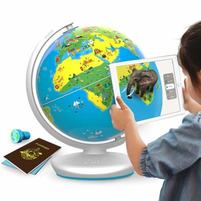 This is an image of a kid using an educational interactive globe toy.