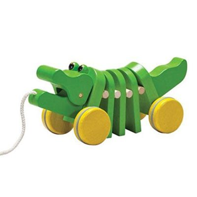 This is an image of a wooden dancing alligator for toddlers.