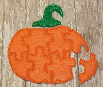 This is an image of a pumpkin jigsaw puzzle for kids.