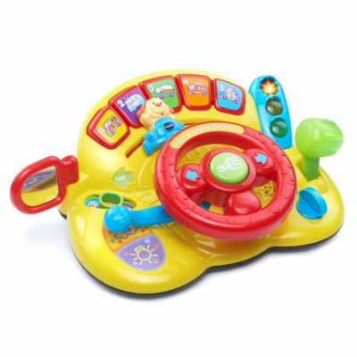 This is an image of a Turn and Learn Driver by Vtech designed for kids.