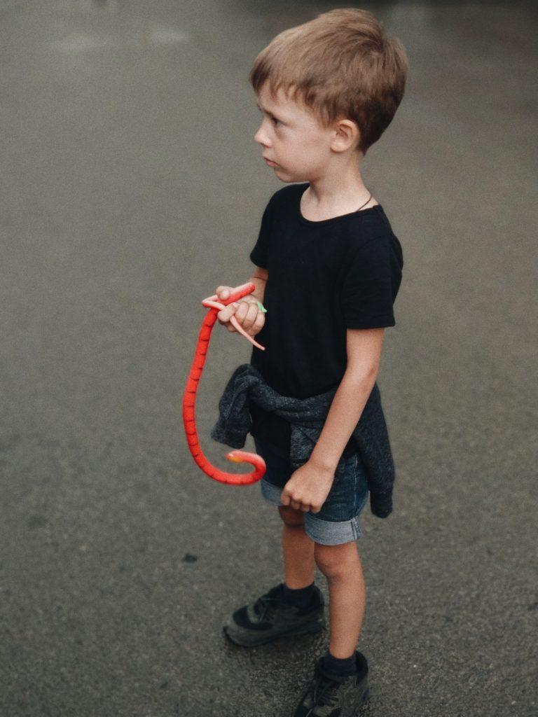 little boy wearing a black shirt and short jean