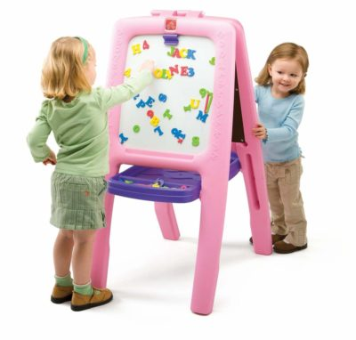 This is an image of two young girls using a double sided pink easel.