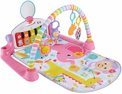 This is an image of a pink kick and play gym for toddlers.