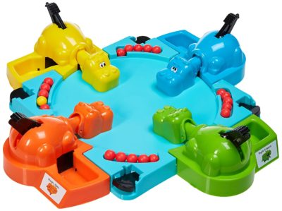 This is an image of a Hungry Hippos feeding board game.
