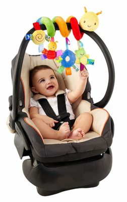 This is an image of a baby playing with a spiral stroller activity toy.