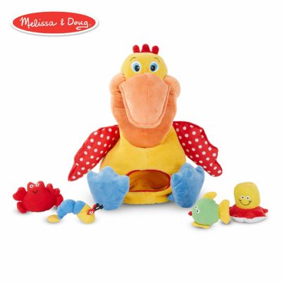 This is an image of a hungry pelican plush toy for toddlers.