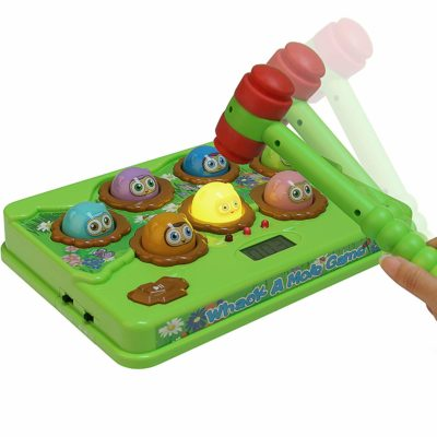 This is an image of a musical wack a mole game with toy hammer for kids.