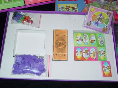 This is an image of a Cashflow board game for kids.