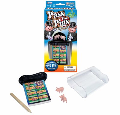 This is an image of a Pass the Pigs dice game by Winning Moves Games.