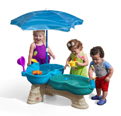 This is an image of a Spill and Splash water table with umbrella by Step2 designed for kids.