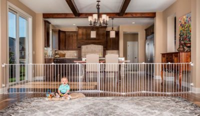 This is an image of a 192 inch adjustable baby gate by Regalo.