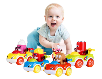 This is an image of a baby playing with toy cars.
