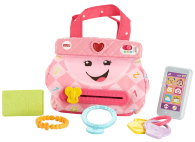 This is an image of a pink toy purse with 5 accessories along with it.
