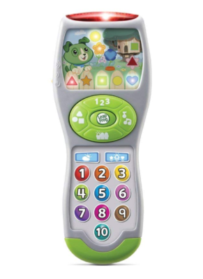 This is an image of a green remote toy for little kids.