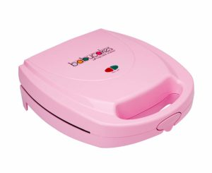 This is an image of a pink cupcake maker machine.