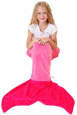 This is an image of a little girl wearing a hot pink mermaid tail blanket.