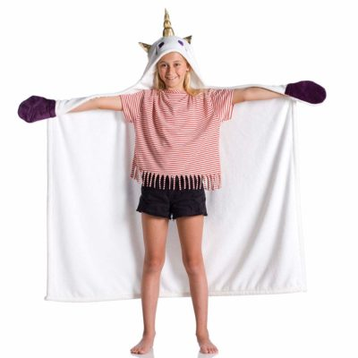 This is an image of a girl wearing a unicorn hooded blanket.