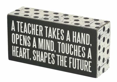 This is an image of a polka dot box sign with message for teachers.