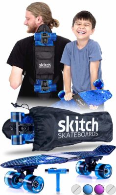 This is an image of a child and man using the blue Skitch skateboard set.