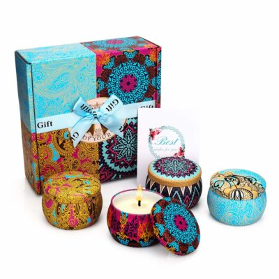 This is an image of a colorful tin candle gift set.