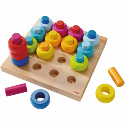 This is an image of a colorful pegs and rings toy by HABA.