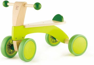 This is an image of a green wooden ride on with rubberized green wheels by Hape.