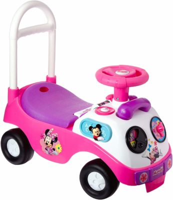 This is an image of a pink Minnie Mouse ride on toy by Kiddieland.