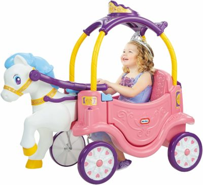 This is an image of a little girl riding on a pink horse and carriage ride on toy by Little Tikes.