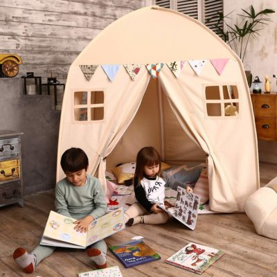 This is an image of a beige house fort play tent by Love Tree.