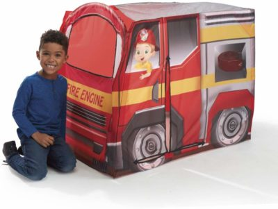 This is an image of a kid beside a red fire engine vehicle tent by Playhut.