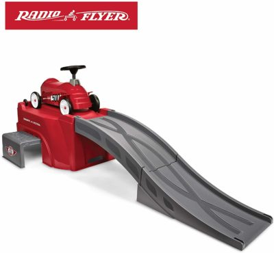 This is an image of a red ride on toy on top of a 6 foot ramp by Radio Flyer.