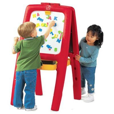 This is an image of two little kids using the magnetic easel board by Step2.