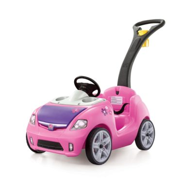 This is an image of a pink ride on push car for little girls.