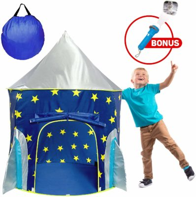 This is an image of a kid playing with the blue rocket tent with a projector toy by USA Toyz.