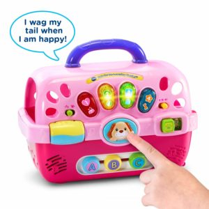 This is an image of a pink pet carrier toy by VTech.