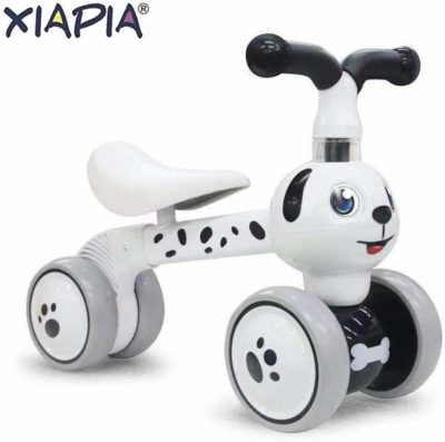 This is an image of a white tricycle bike with dalmatian prints by XIAPIA.