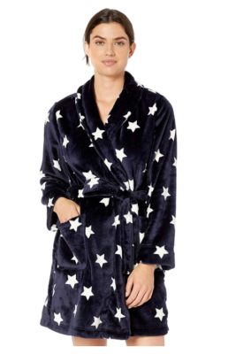 This is an image of a lady wearing a plush robe with navy star print by Amazon Essentials.