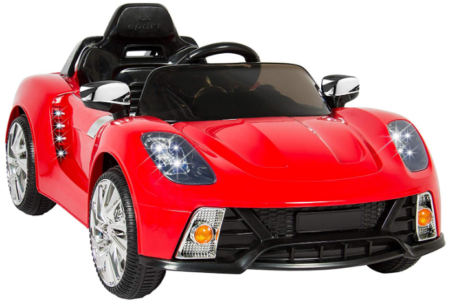 This is an image of girl's power wheels with remote control car in orange color