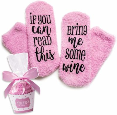 This is an image of a pink wine socks in cupcake packaging by Cinch!