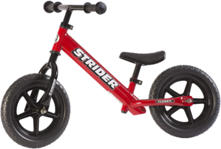 This is an image of toddler's classic balance bike in red color