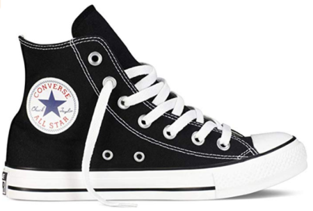 This is an image of boy's converse sneaker in white and black colors