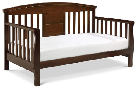 This is an image of toddler's convertible toddler bed in brown color