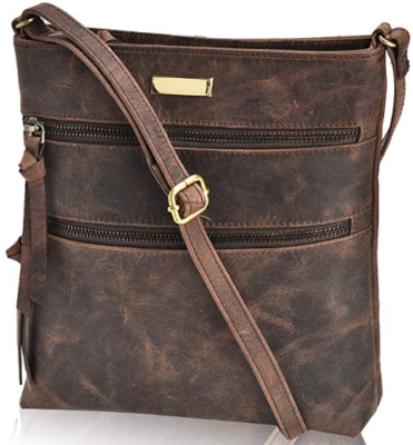 This is an image of girl's crossbody bag purse in brown color