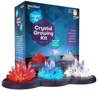 This is an image of boy's crystal growning kit in blue, white and red colors