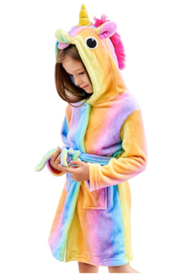 This is an image of a little girl wearing a rainbow unicorn sleepwear by Doctor Unicorn.
