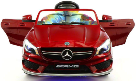 This is an image of girl's power wheels Mercedes Electric car in red color