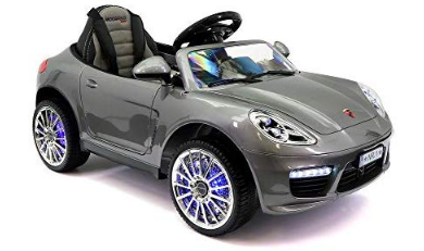 This is an image of girl's power wheels car in gray color