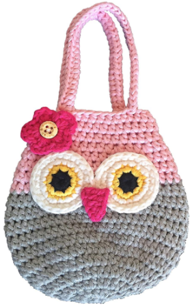 This is an image of girl's owl mini purse in colorful colors